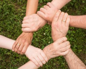 Family Therapy is a Critical Component of Drug Rehab, hands locked in support, Foundations Wellness Center
