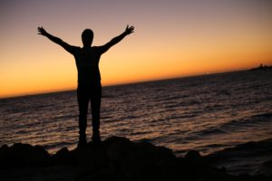 Man holding arms to heaven, drug rehab, Foundations Wellness Center