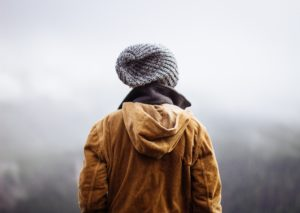 Person in Coat and Hat looking at a foggy view, Tricare drug rehab, Foundations Wellness Center