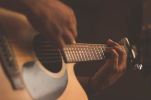 Closeup of Guitar While Being Played, What is Holistic Addiction Treatment, Foundations Wellness Center