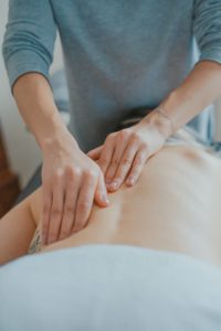 Person Receiving Massage Therapy, What is Holistic Addiction Therapy, Foundations Wellness Center