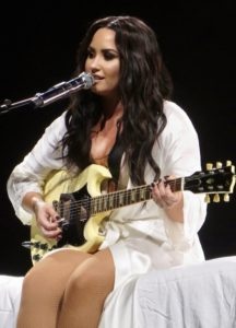 Demi Lovato sings while playing guitar, What Demi Lovato can teach us about addiction recovery, Foundations Wellness Center