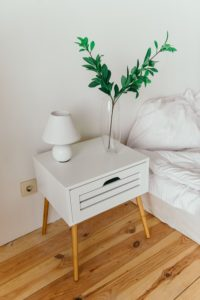 Bed with nightstand, lamp and vase, Marchman Act Florida, what you need to know, Foundations Wellness Center