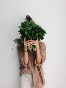 Woman Hiding Behind Greens, Relapse Prevention, Foundations Wellness Center