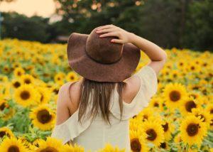 photo-of-woman-in-a-sunflower-field, florida-opioid-mat-treatment-program, Foundations Wellness Center