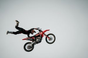 man-performing-stunt-on-motorcycle, what is an addictive personality, Foundations Wellness Center