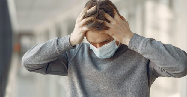 Man in Mask with Hands in His Hair, coronavirus caused you to relapse 9 ways to get back on track, Foundations Wellness Center