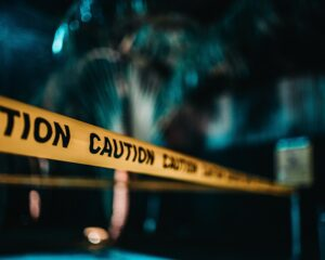 caution tape around a blurred accident, is weed addictive, Foundations Wellness Center