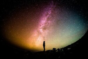 person looking at milky way against night sky, 8 lies addicts tell, Foundations Wellness Center