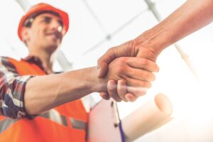 Construction-employee-shaking-superviors-hand-going-back-to-work-after-rehab-Foundations-Wellness-Center
