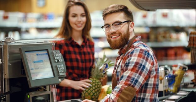 Image,Of,Cheerful,Cashier,Man,On,Workspace,In,Supermarket,Shop, Going back to work after rehab, Foundations Wellness Center