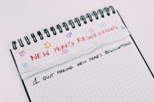pad of paper with New Year's Resolutions, 1, quit making New Years Resolutions written on it